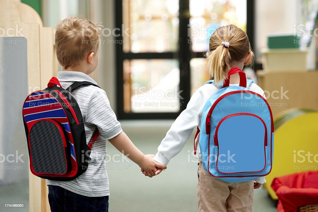 Young children walking to school stock photo