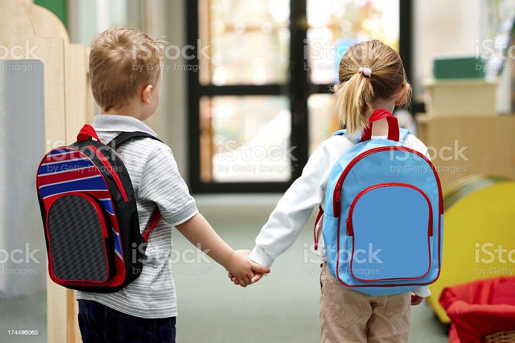Young children walking to school stock photo