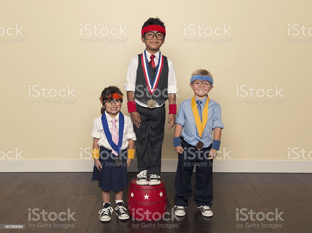 Young Children wearing Medals from Office Competition stock photo