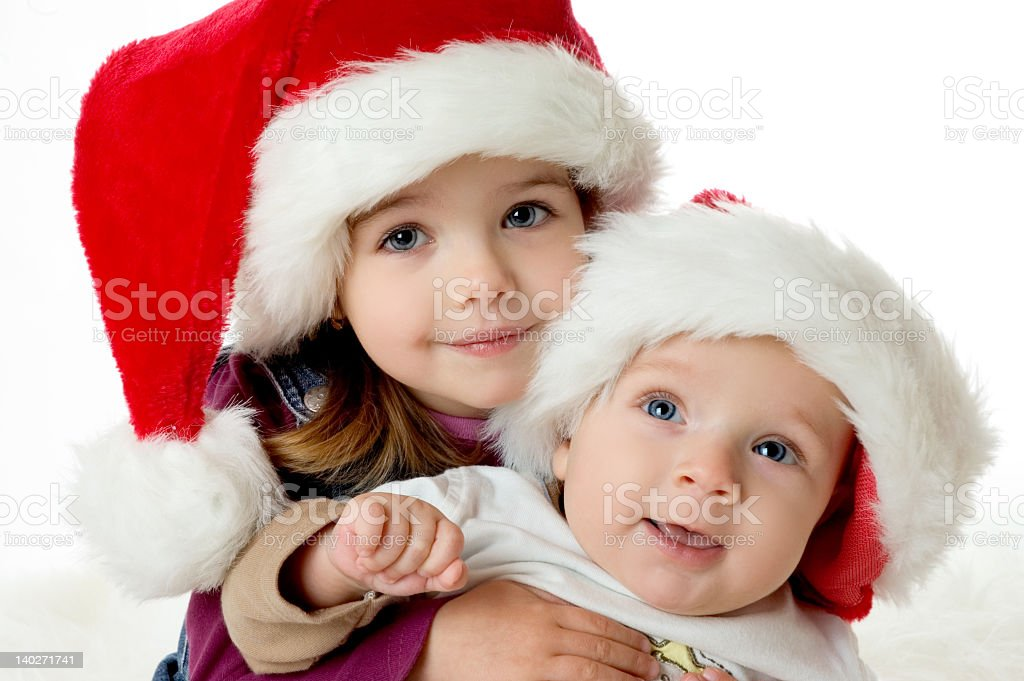Young children wearing Santa hats royalty-free stock photo