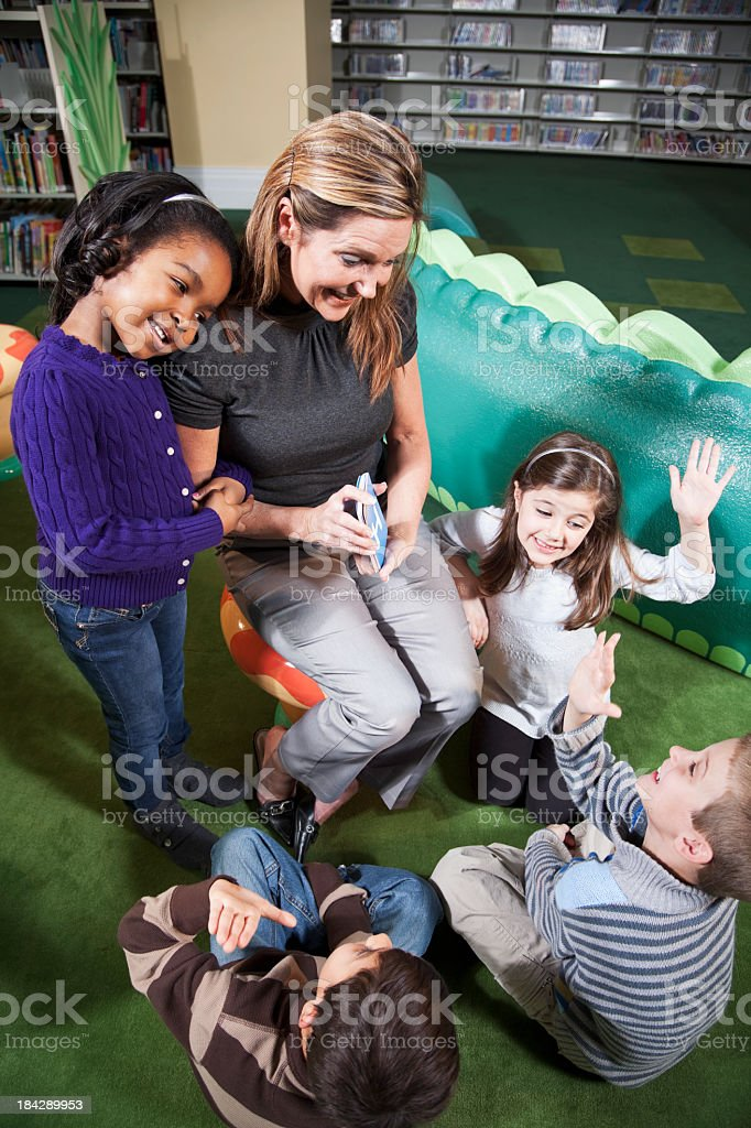 Young children with teacher at school stock photo