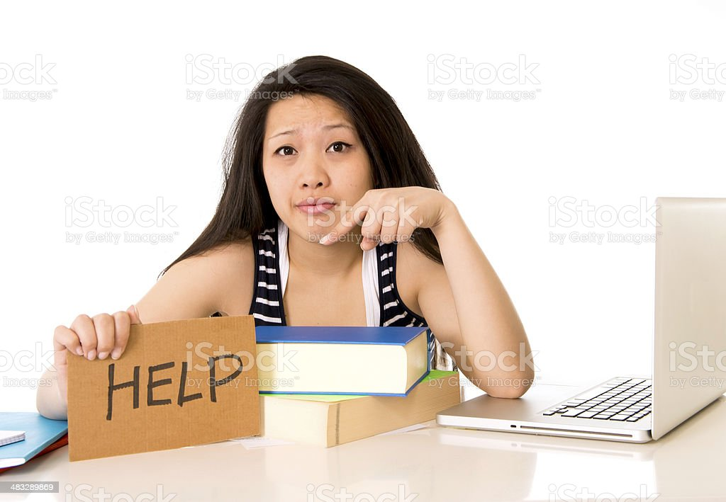 young chinese asian holding a help sign working on computer royalty-free stock photo