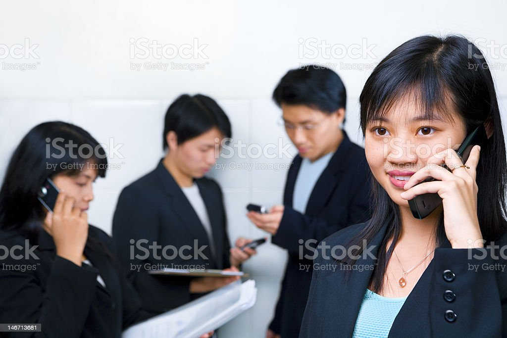 Young Chinese businesswoman talking on cell phone royalty-free stock photo