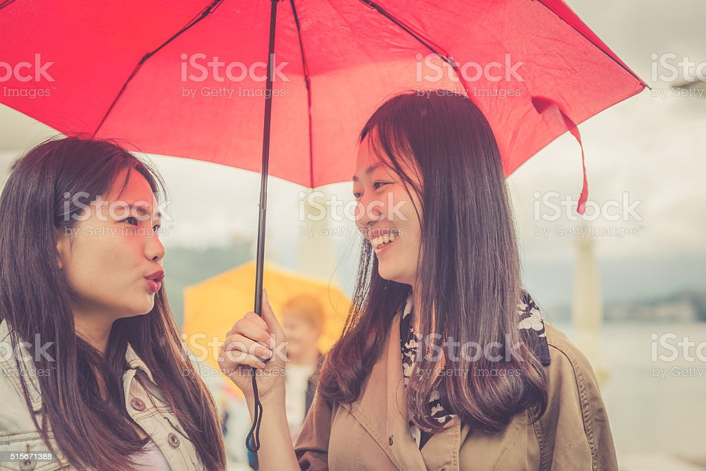 Young Chinese Friends Talking, Rainy, Bled, Slovenia, Europe stock photo