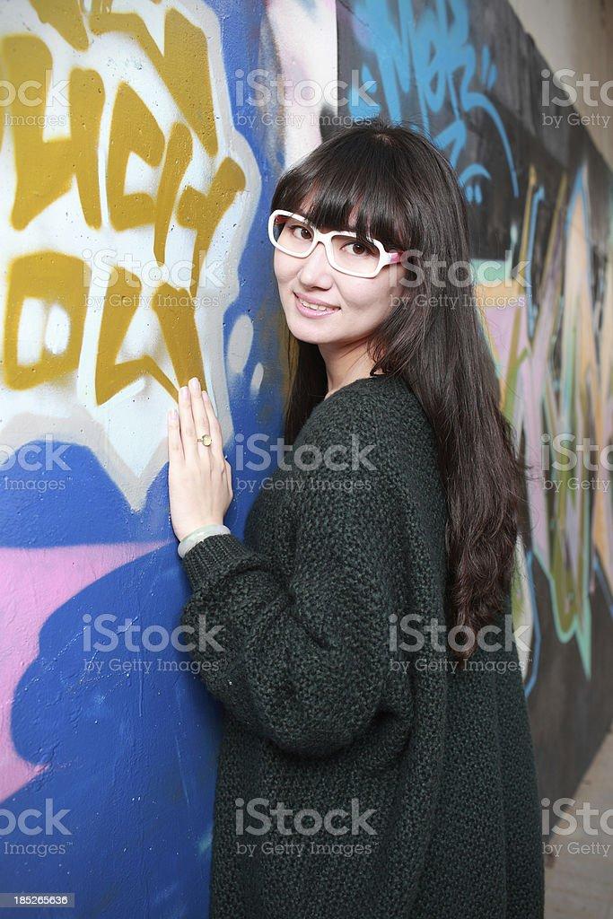 young Chinese girl Painting graffiti royalty-free stock photo