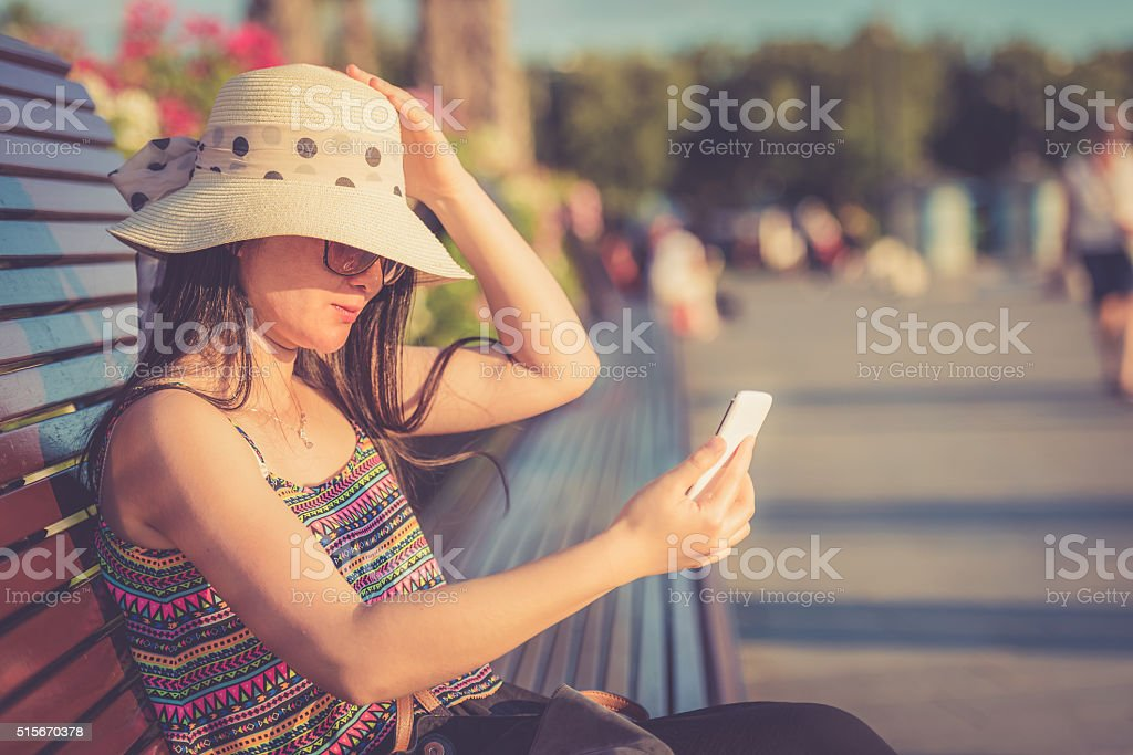 Young Chinese Woman Looking at Smart Phone, Koper, Slovenia, Europe stock photo