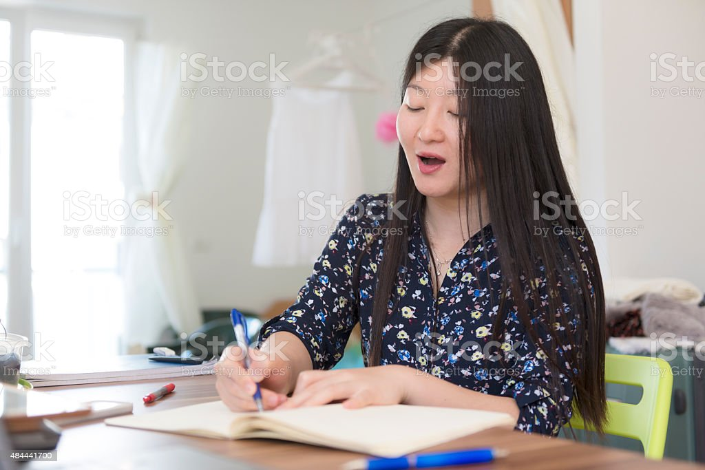 Young Chinese Woman Studying at Home, Koper, Slovenia, Europe stock photo