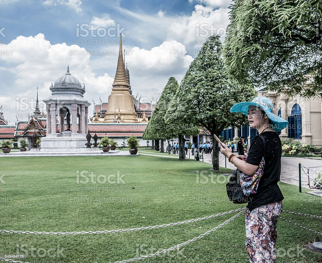 Young Chinese Woman Tourist with Mobile Phone stock photo