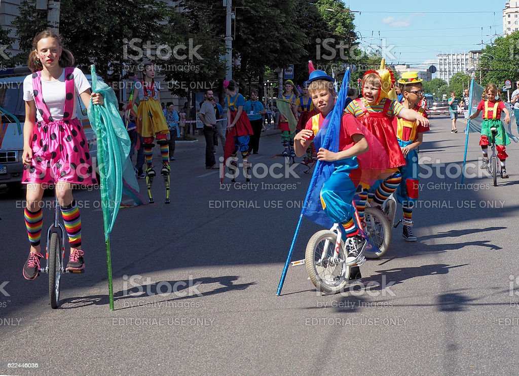 Young circus performers on cycles stock photo