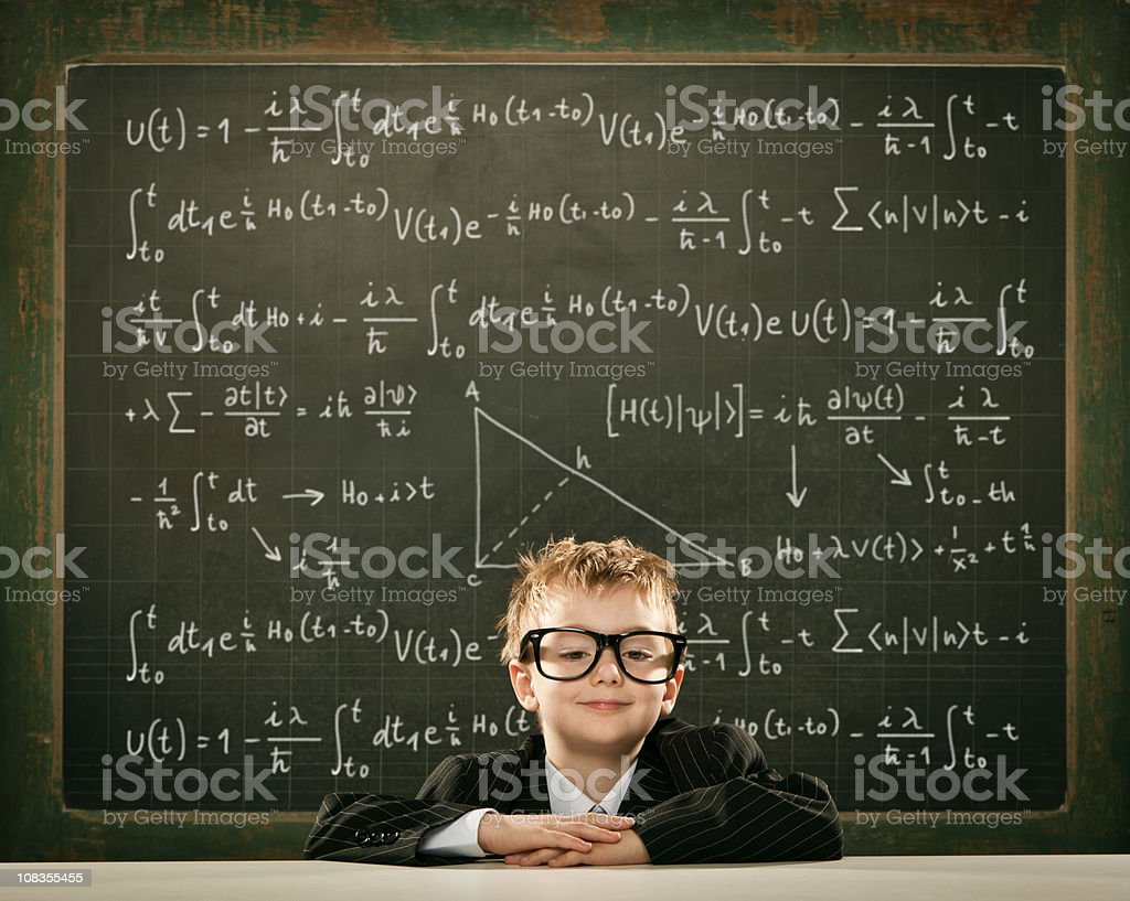 young clever science student crossed arms with formula written blackboard royalty-free stock photo