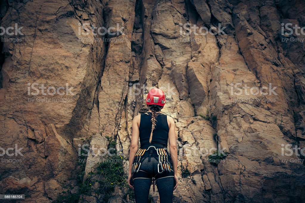 Young climber getting ready for rock climbing stock photo