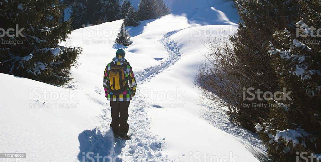 Young climber on the footpath in snowy mountains royalty-free stock photo