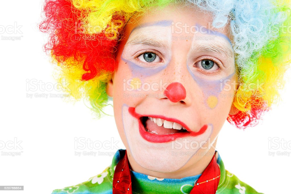 Young clown grimacing stock photo