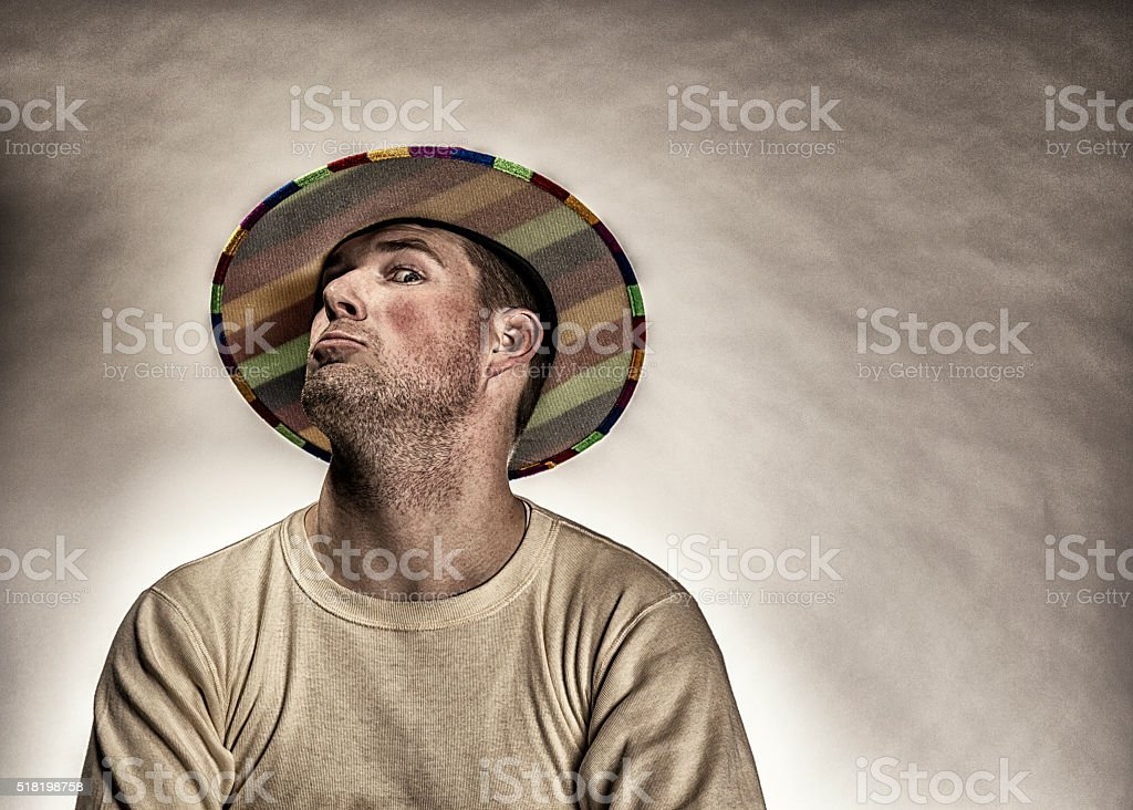 Young Clown Hat Man Making a Silly Face Studio Portrait stock photo