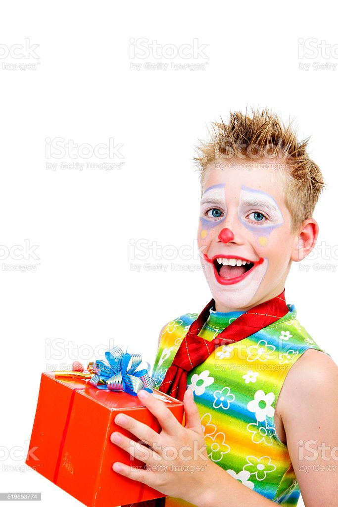 Young clown with a gift stock photo