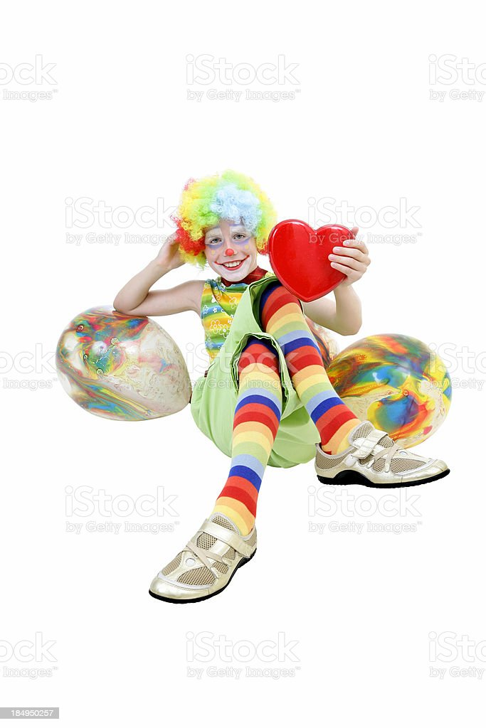 Young clown with heart and balloons royalty-free stock photo