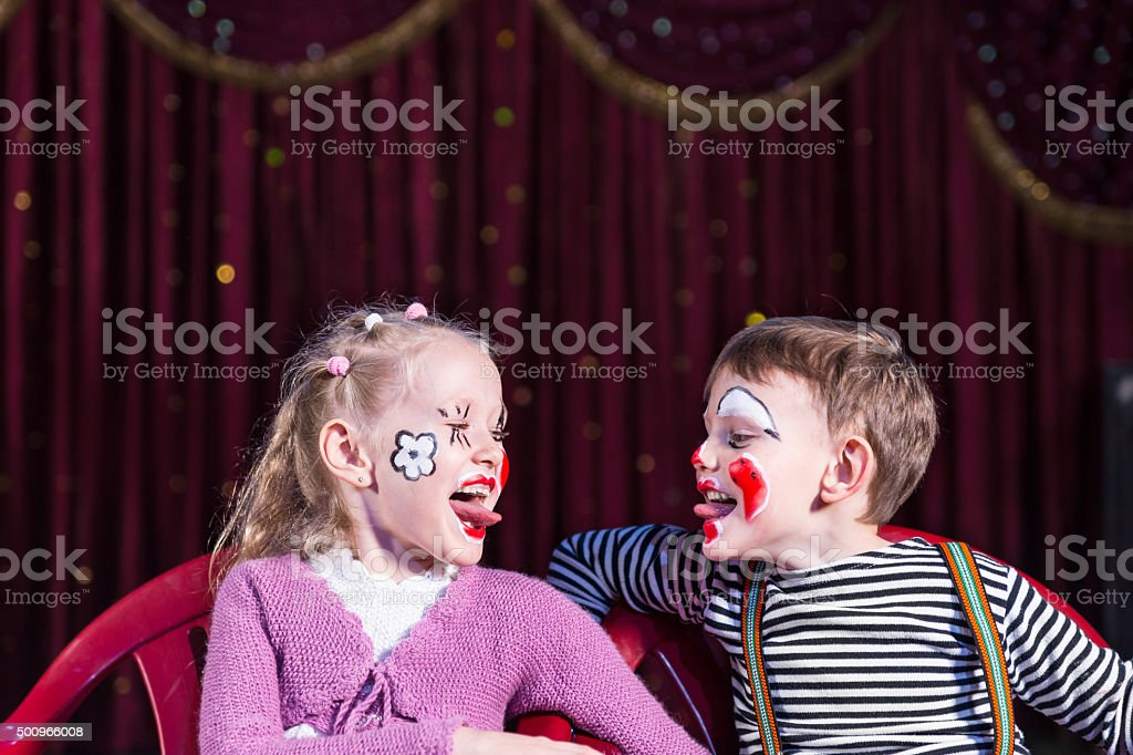 Young Clowns Sticking Tongues Out at Each Other stock photo