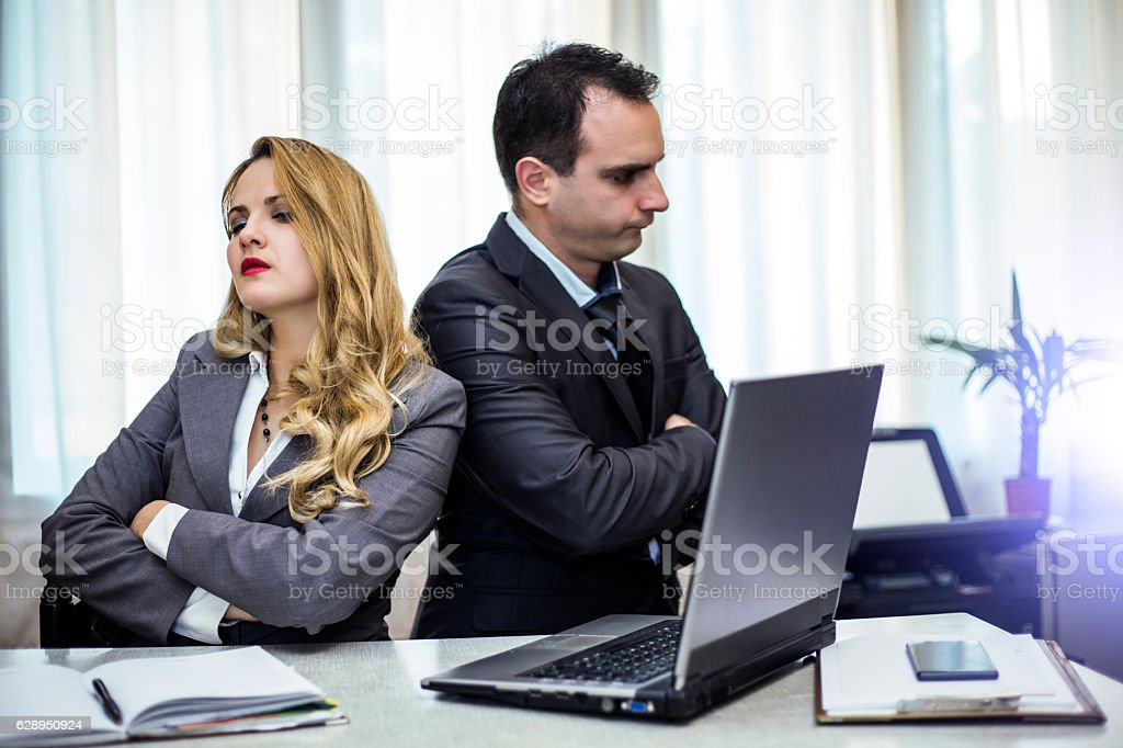 Young colleagues having problems in workplace stock photo