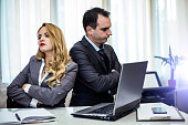 Young colleagues having problems in workplace