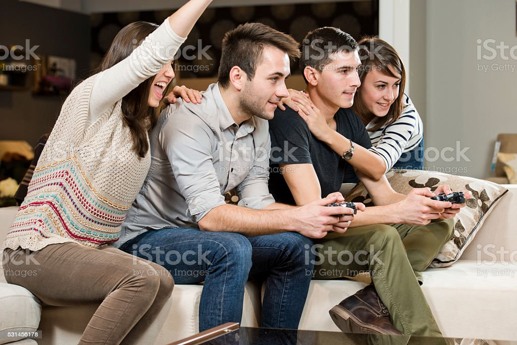 Young colleagues playing video games stock photo