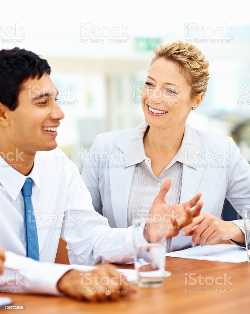 Young colleagues sitting together with business plans royalty-free stock photo