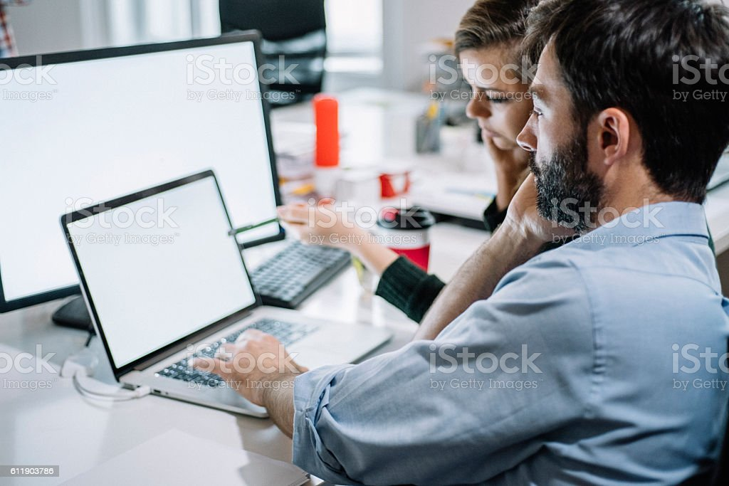 Young colleagues working on a project stock photo