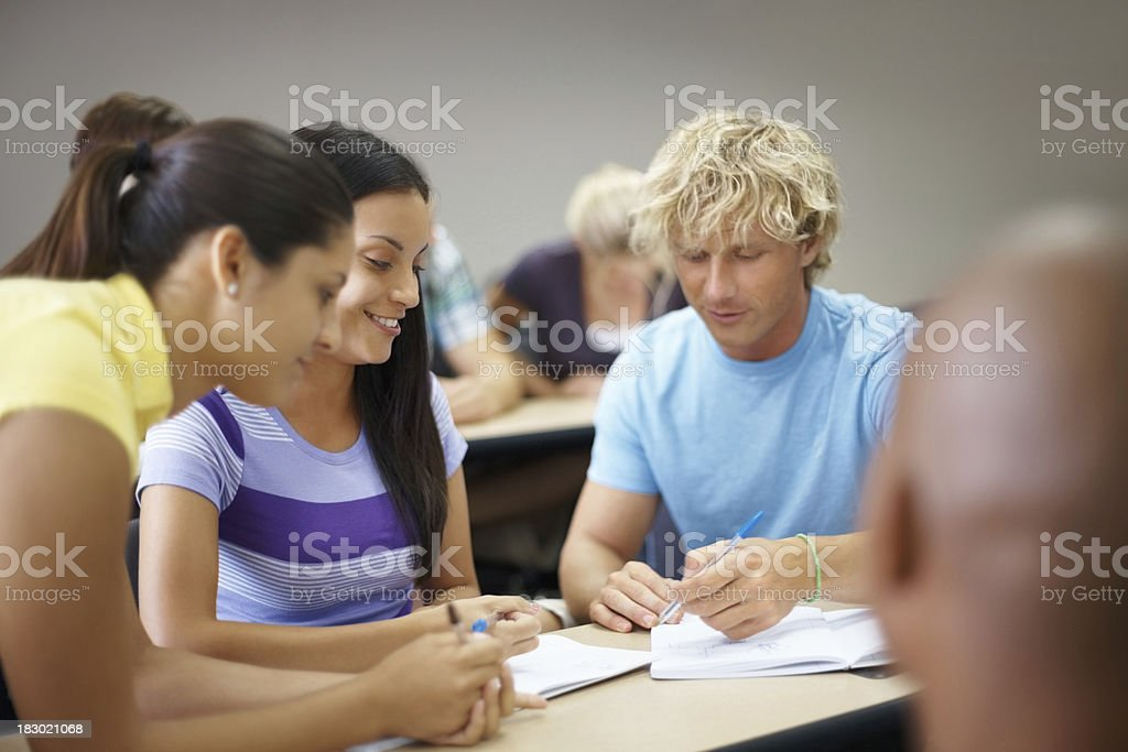 Young college friends studying together in class royalty-free stock photo