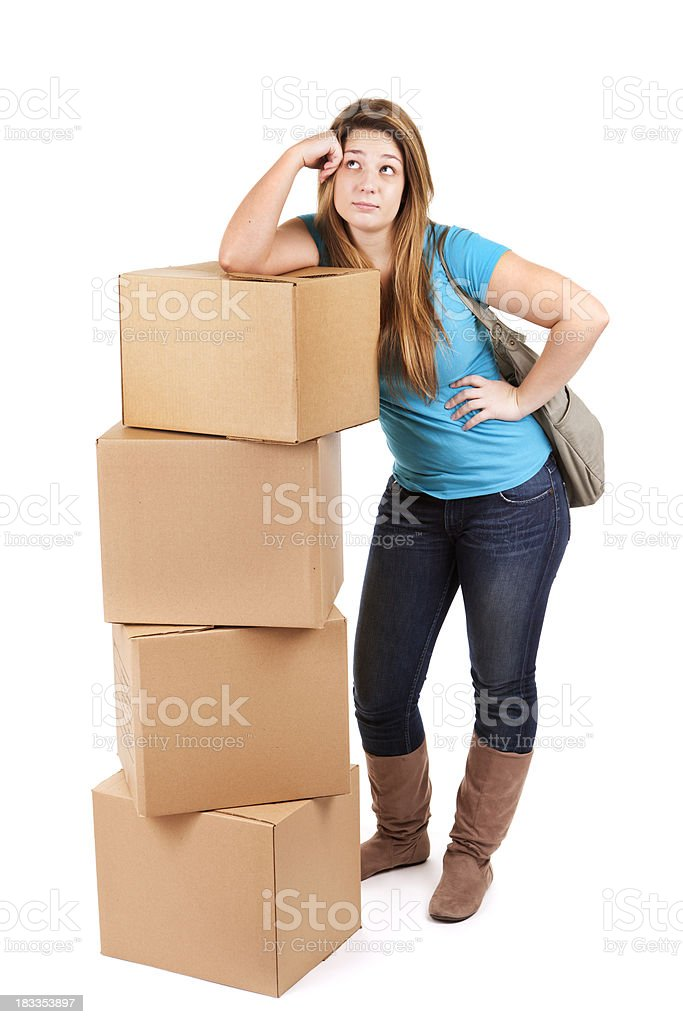 Young College Student Moving into Dormitory with Boxes on White royalty-free stock photo