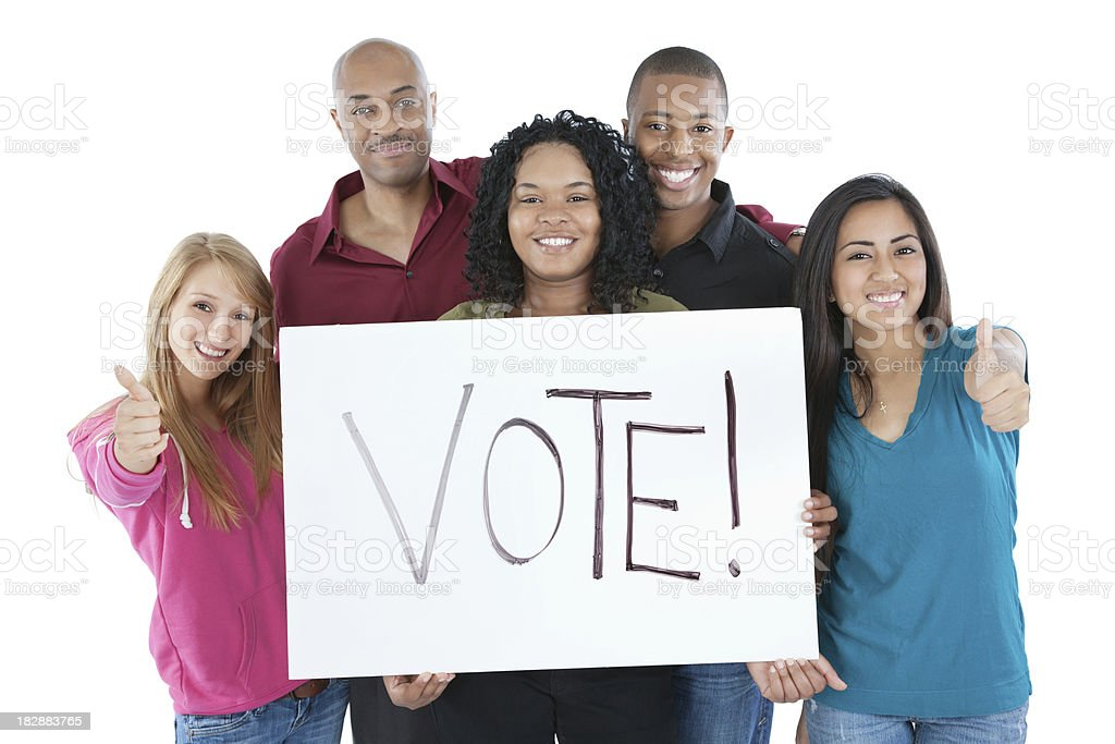 Young College Students Holding Vote! Sign, Isolated on white stock photo