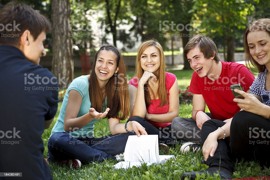 Young college students relaxing outdoors royalty-free stock photo