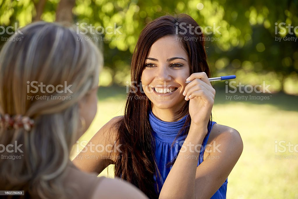 Young college students talking and studying for university exam royalty-free stock photo