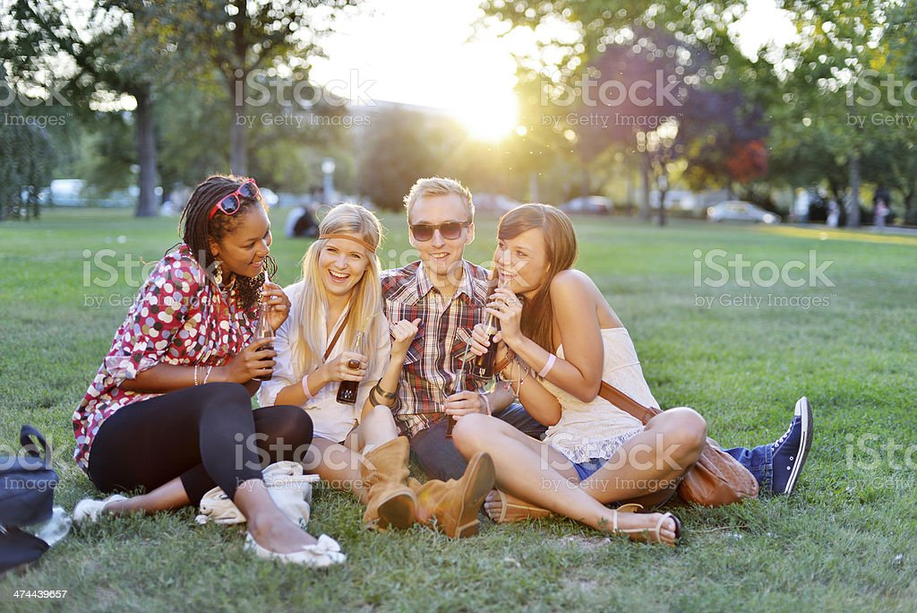Young college students together in the park stock photo