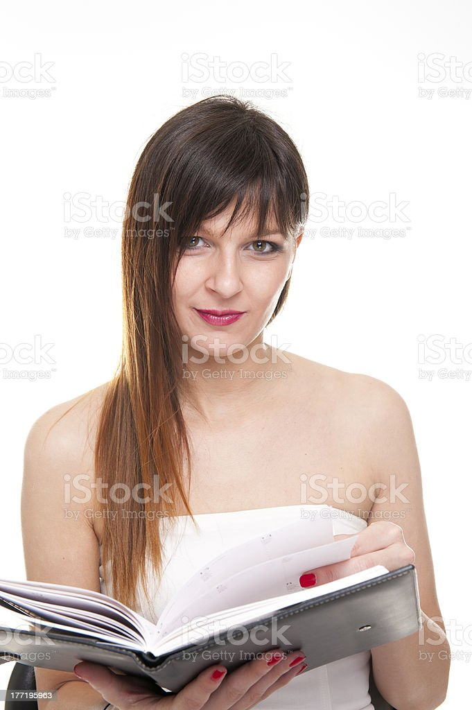 Young concentrated business woman holding a notepad royalty-free stock photo
