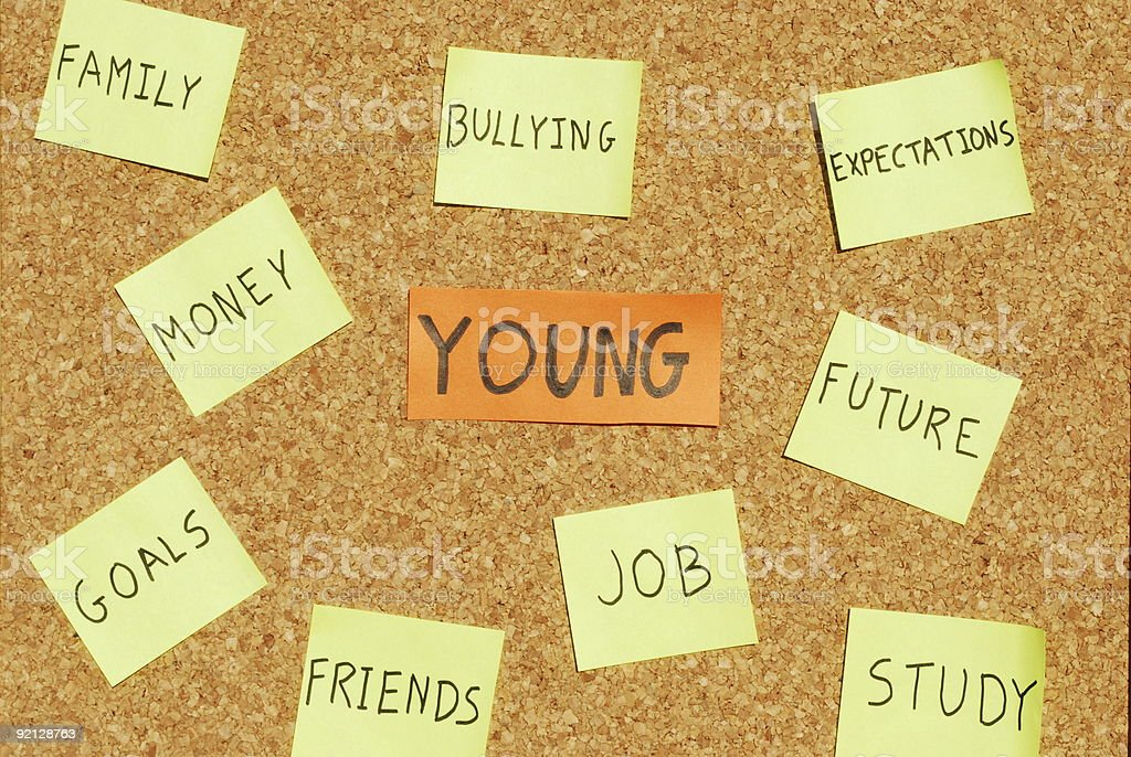 Young concerns on a cork board royalty-free stock photo