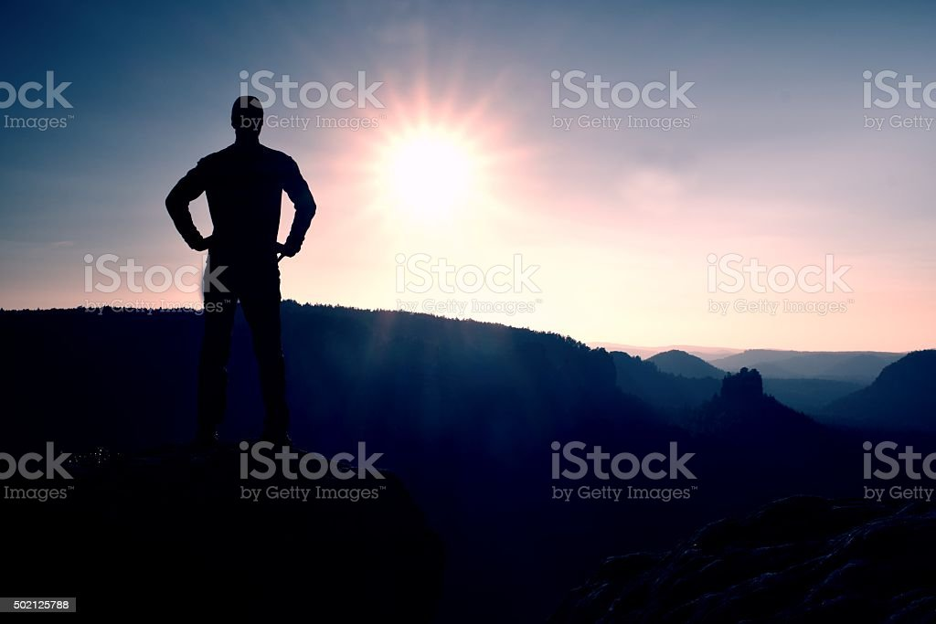 Young Confident and Powerful Man Standing with Hands on Hips, stock photo