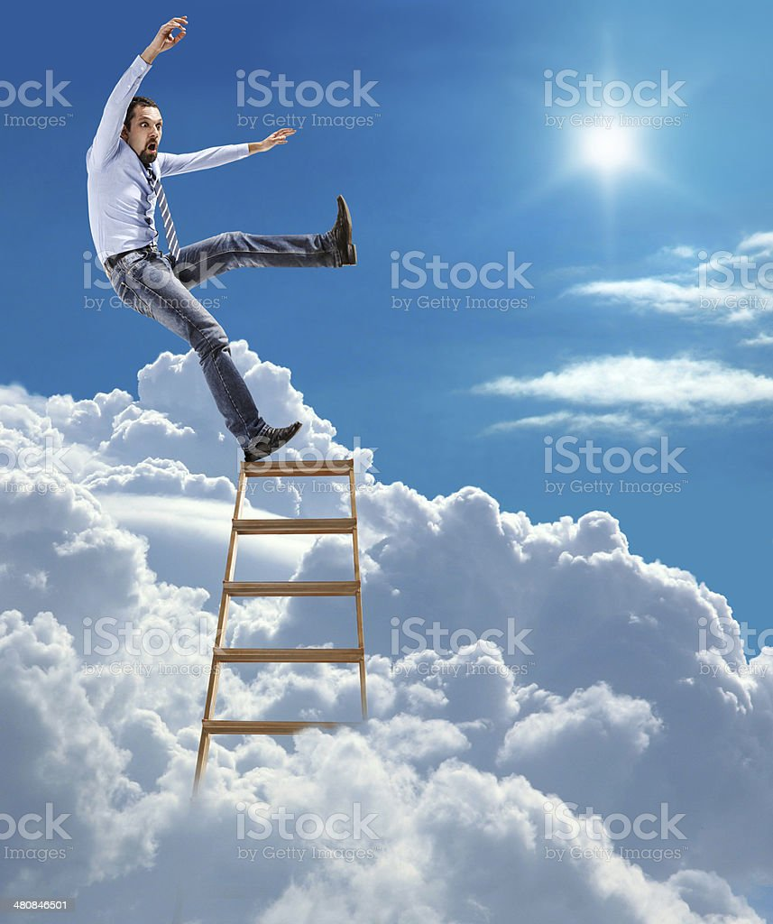 young confident businessman falls from the top stock photo