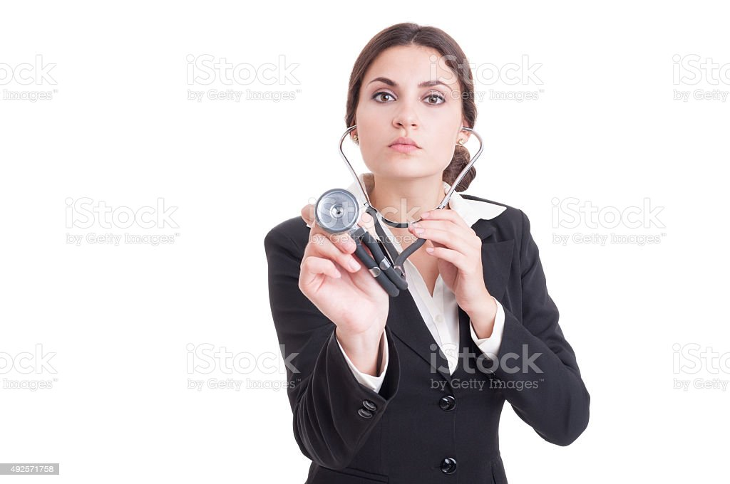 Young confident female doctor or medic holding stethoscope to ca stock photo