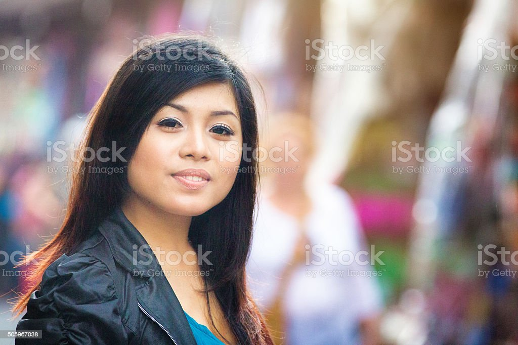 Young confident Indonesian woman portrait at Ubud market stock photo
