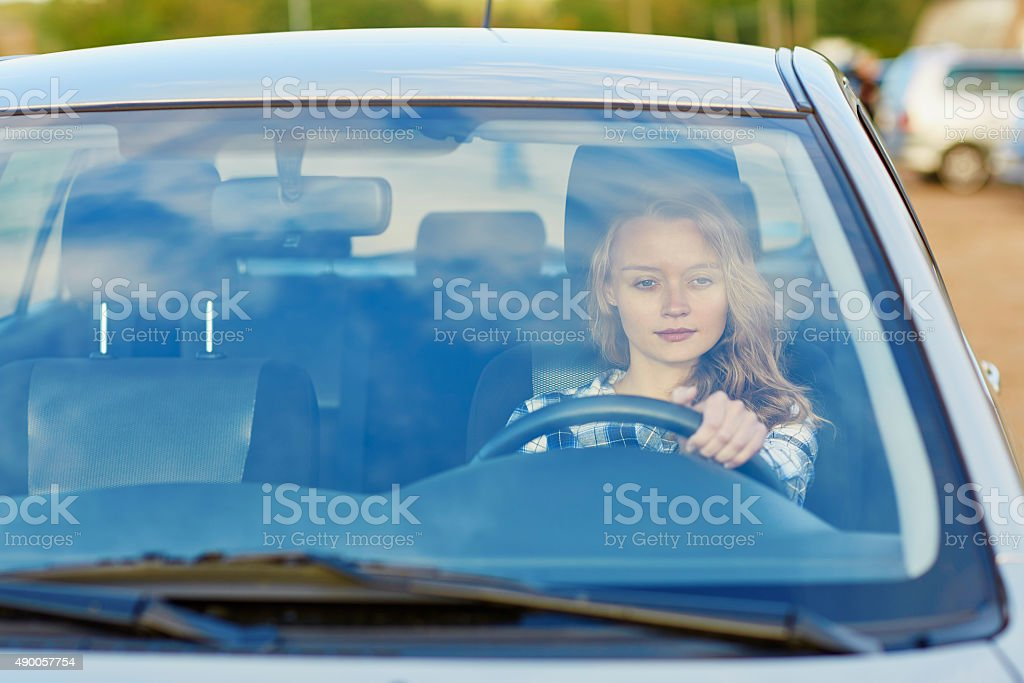 Young confident woman driving a car stock photo