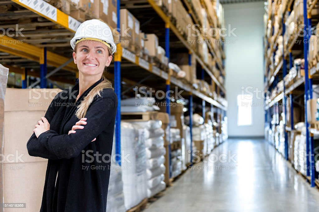 Young confident woman in warehouse stock photo