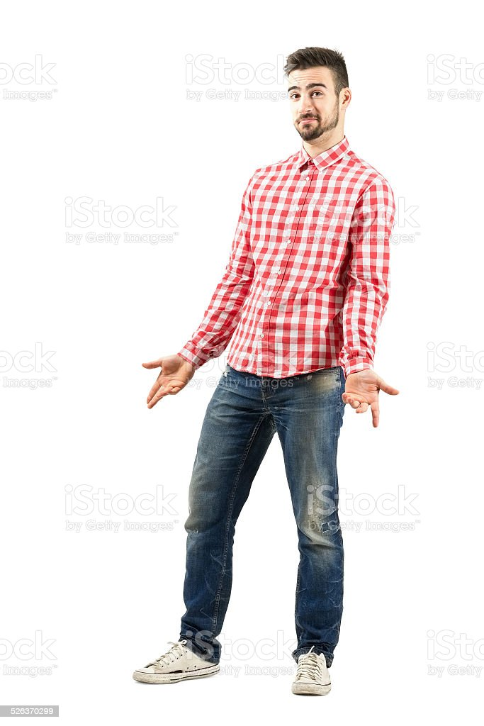 Young confused unsure man in plaid shirt shrugging stock photo