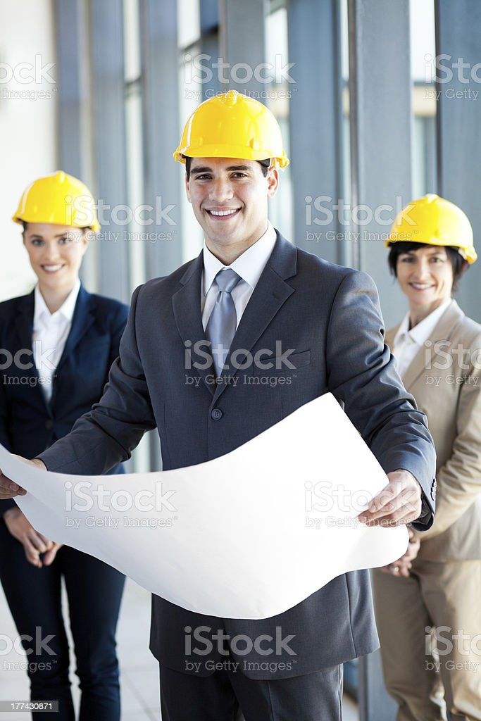 young construction manager holding blue print royalty-free stock photo