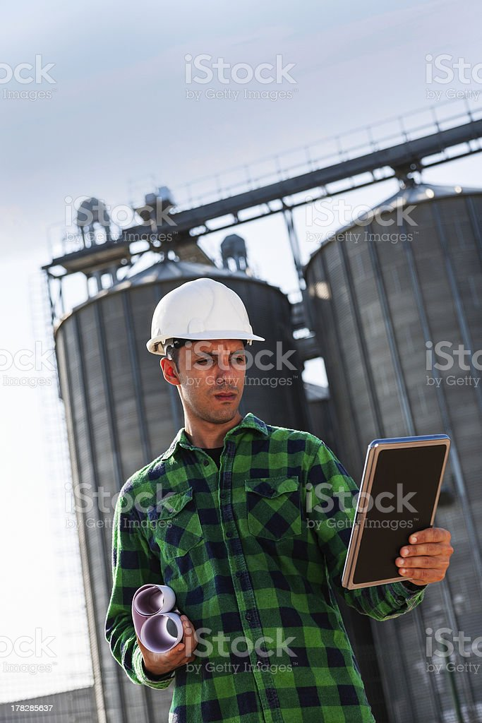 Young construction worker checking his tablet pc royalty-free stock photo