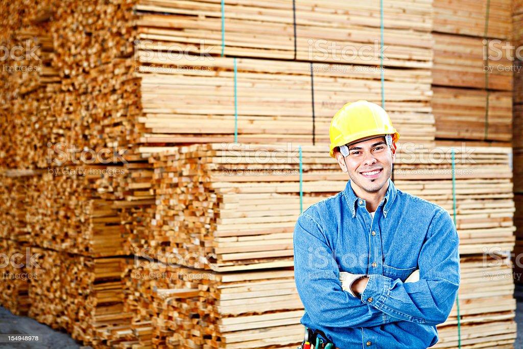 Young construction worker crossed armes smiling big royalty-free stock photo