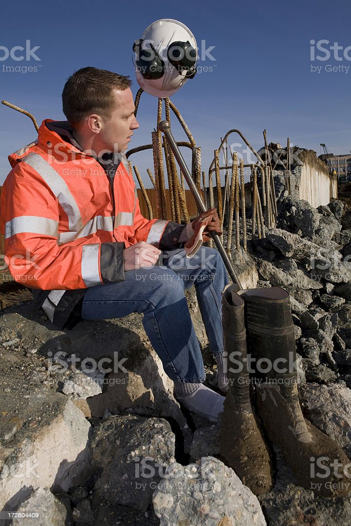 Young construction worker on a building pit royalty-free stock photo