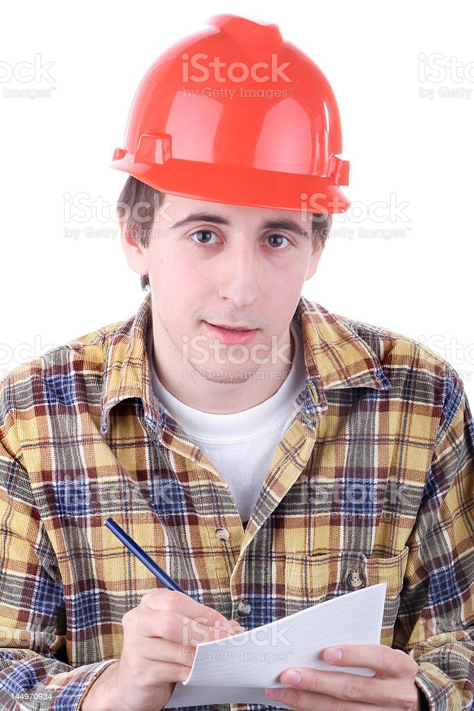 Young construction worker taking notes isolated on white royalty-free stock photo