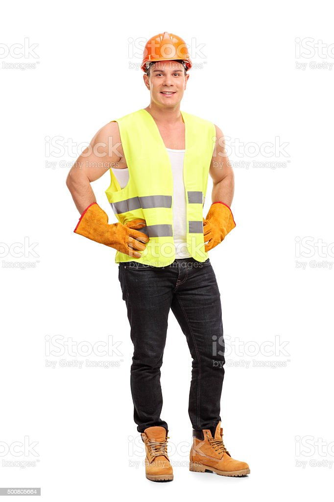 Young construction worker with a helmet stock photo