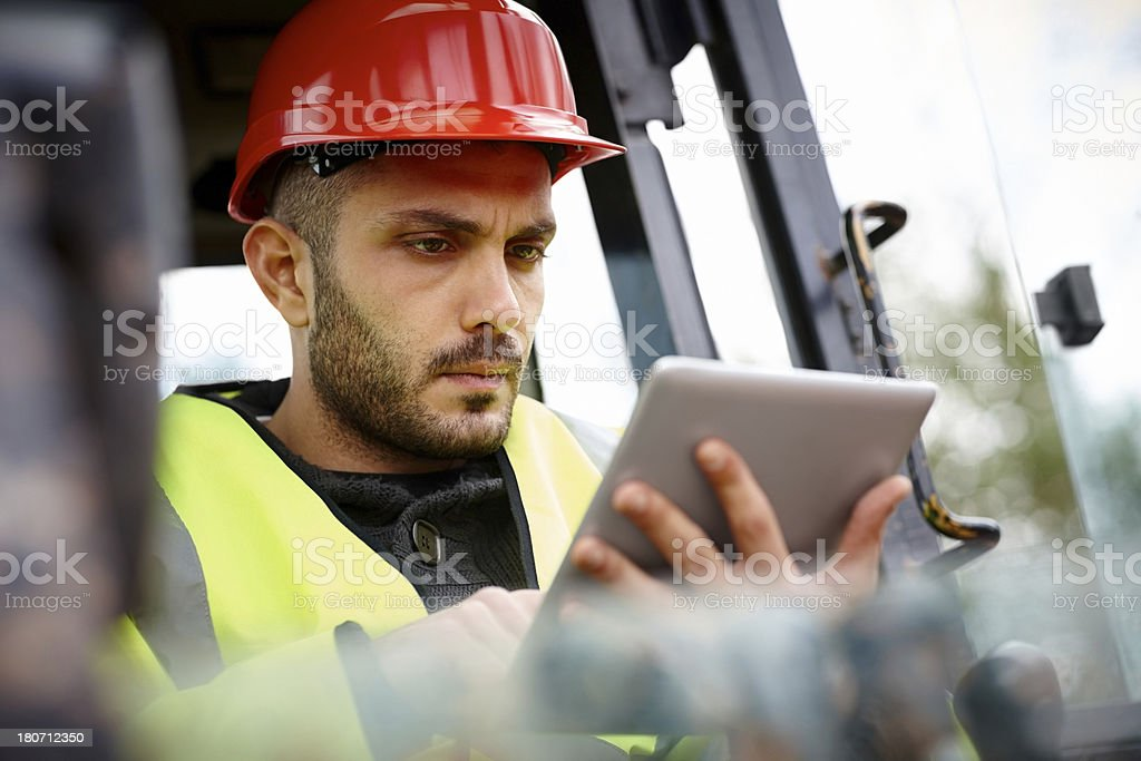 Young construction worker with digital tablet royalty-free stock photo