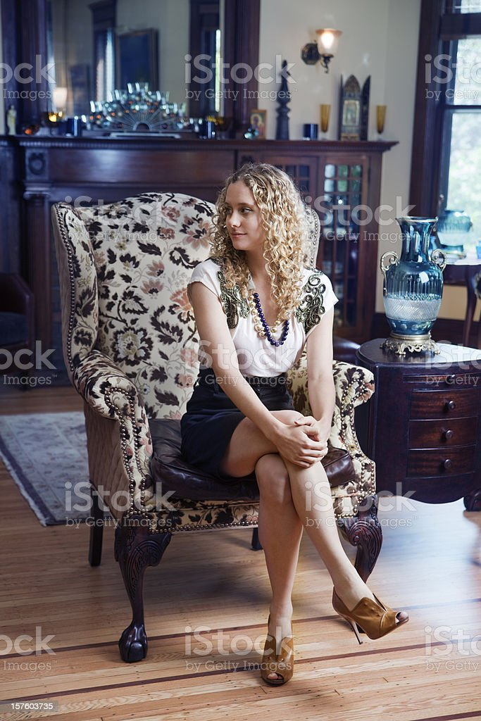 Young Contemporary Woman in Traditional Home Interior royalty-free stock photo