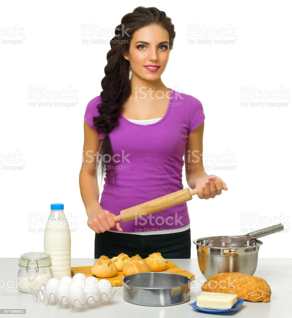Young cooking woman isolated stock photo